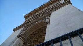 View from the bottom up to the Arc de Triomphe stock video footage