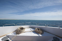 View from bow of a large private motor yacht out at sea Stock Image