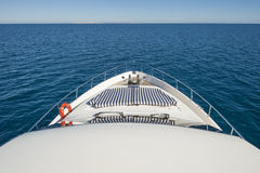 View from the bow of a private motor yacht. View over tropical ocean from the bow of a luxury large private motor yacht with horizon Stock Image