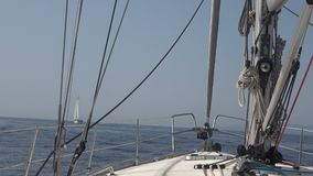 View from the Bow of the Yacht. Point of view from the bow of a sailing yacht that travels in the sea stock video