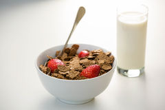 View of a bowl of cereals and glass of milk royalty free stock image
