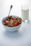 View of a bowl of cereals and glass of milk stock image