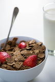 View of a bowl of cereals and glass of milk Royalty Free Stock Images