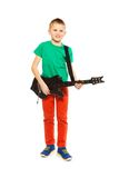 View of boy playing on electro guitar standing Royalty Free Stock Images
