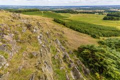 A view of Bradgate Park, Leicestershire and the city of Leicester. A view past the 560 million year old Precambrian rocks in Bradgate Park, Leicestershire Stock Image