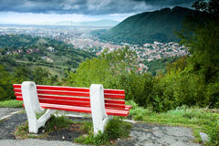 The view of Brasov. A bench in the middle of the road between Brasov and Poina Brasov which has a view of all the Brasov city Stock Photography