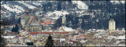 View of Brasov center in a winter day, Romania  Tampa mountain top. Beautiful view of Brasov center in a winter day, Romania Royalty Free Stock Image