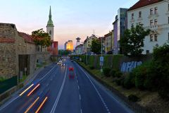 View of Bratislava city with St. Martin`s Cathedral,Slovakia. View of Bratislava city street with St. Martin`s Cathedral in capital city of Slovakia royalty free stock photo