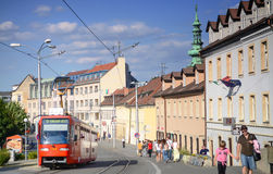 View of Bratislava downtown life, red tram, people, sunset,store, catherdral, skyline Royalty Free Stock Images