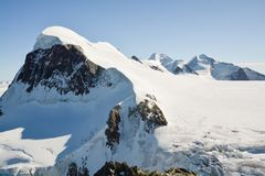 View on Breithorn from Klein Matterhorn. Breithorn is considered to be one of the most accessible 4000 peak Stock Photo