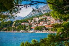 View of the Brela village through green pines royalty free stock photo