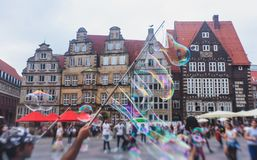 View of Bremen market square with Town Hall, Roland statue and crowd of people, historical center, Germany Royalty Free Stock Photos