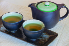 View of the Brewed and healthy Japanese green tea served in traditional hohin and shiboridashi dishes Stock Photos