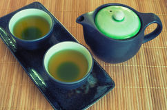 View of the Brewed and healthy Japanese green tea served in traditional hohin and shiboridashi dishes Stock Image