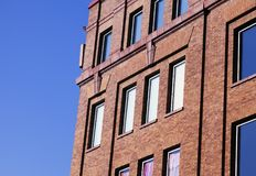 A view of a brick building in NYC in a blue clear sky.  Stock Photography