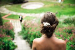 Bride looking down where her groom is waiting royalty free stock images