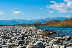 View of the bridge across mountain river with stony shore Royalty Free Stock Images