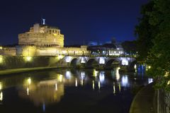 View of the bridge and the Angel Castle at night in the illumination over the Tiber River. Rome. Italy.  stock photo