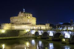 View of the bridge and the Angel Castle at night in the illumination over the Tiber River. Rome. Italy.  royalty free stock photos
