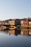 View on bridge on arno river in florence in italy with reflection Royalty Free Stock Photography