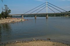 View at bridge and beach at other side of river Danube, Novi Sad, Serbia. View at bridge, and beach at other side of river Danube, Novi Sad, Serbia Stock Photography