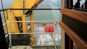 View from the bridge deck of the tug on anchor buoy. Powered winch. Daytime. Swell on the Baltic Sea. stock video