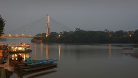 View of the bridge of El Coca on the Napo River at sunset. This bridge is the most important infrastructure project of the town Stock Photography