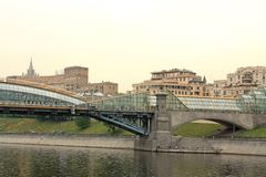 View of the bridge and embankment across the river Royalty Free Stock Images