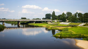View on bridge and embankment of Warta river in polish town Konin. Royalty Free Stock Photography
