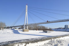 View of the bridge fallen in love in Tyumen in the winter, Russi Stock Images