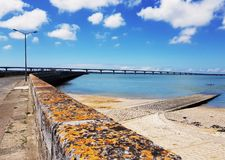 View of the bridge of the island of Oleron, from Bourcefranc-le-Chapus. With blue sea and sky stock image