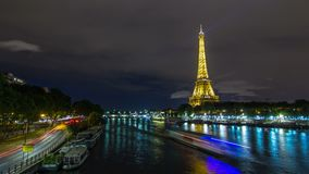 View on the bridge of Jena with Eiffel tower night timelapse hyperlapse, which connects the Champ de Mars gardens and. View on the bridge of Jena night timelapse stock footage