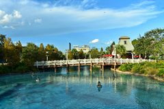 View of bridge, lamps floating above lake on lightblue cloudy background at Lake Buena Vista. stock image