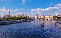 View from bridge in Moscow. Bridge and boat at Moskva river in Moscow, Russia - panoramic Stock Image