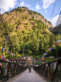 View of the bridge over Parvati river. Manikaran with thermal springs is a pilgrimage centre for Hindus and Sikhs. April, 24th, 2016 - Manikaran, Parvati valley Royalty Free Stock Photography