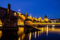 View of Bridge over River at Night Stock Photography