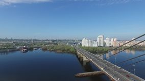 View of the bridge over the river, the road junction, the city sleeping area stock footage
