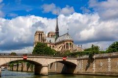 Notre-Dame de Paris cathedral under beautiful sky stock images