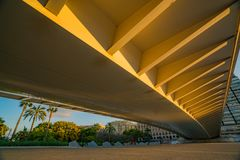 View of the bridge over the Turia park and sports people during sunset. Valencia. Royalty Free Stock Photos