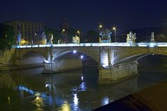 View of the bridge to the Angel Castle at night in the illumination over the Tiber River. Rome. Italy.  stock photos