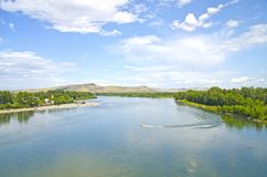 View from the bridge to the river. Water skiing stock image