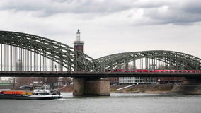 View of the bridge from the train and river barge stock footage