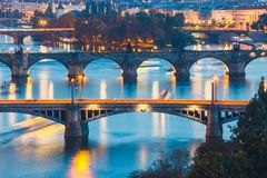 Bridges with historic Charles Bridge and Vltava river at night in Prague, Czech Republic Stock Photography