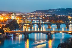 Bridges with historic Charles Bridge and Vltava river at night in Prague. View of bridges with historic Charles Bridge and Vltava river at night in Prague, Czech Stock Photography