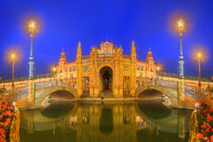 View of bridges and lights in Spain Square at evening, landmark in Renaissance Revival style, Seville, Andalusia, Spain Stock Image
