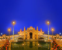 View of bridges and lights in Spain Square at evening, landmark in Renaissance Revival style, Seville, Andalusia, Spain Stock Images