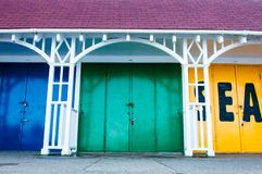 View of Bright colored beach huts on summer day Stock Photography