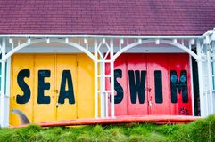 View of Bright colored beach huts on summer day Royalty Free Stock Images
