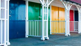 View of Bright colored beach huts on summer day Stock Images
