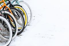 View of the bright wheels of bicycles that stand in the snow stock image